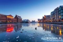 Old town in Gdansk with frozen Motlawa river at dusk, Poland